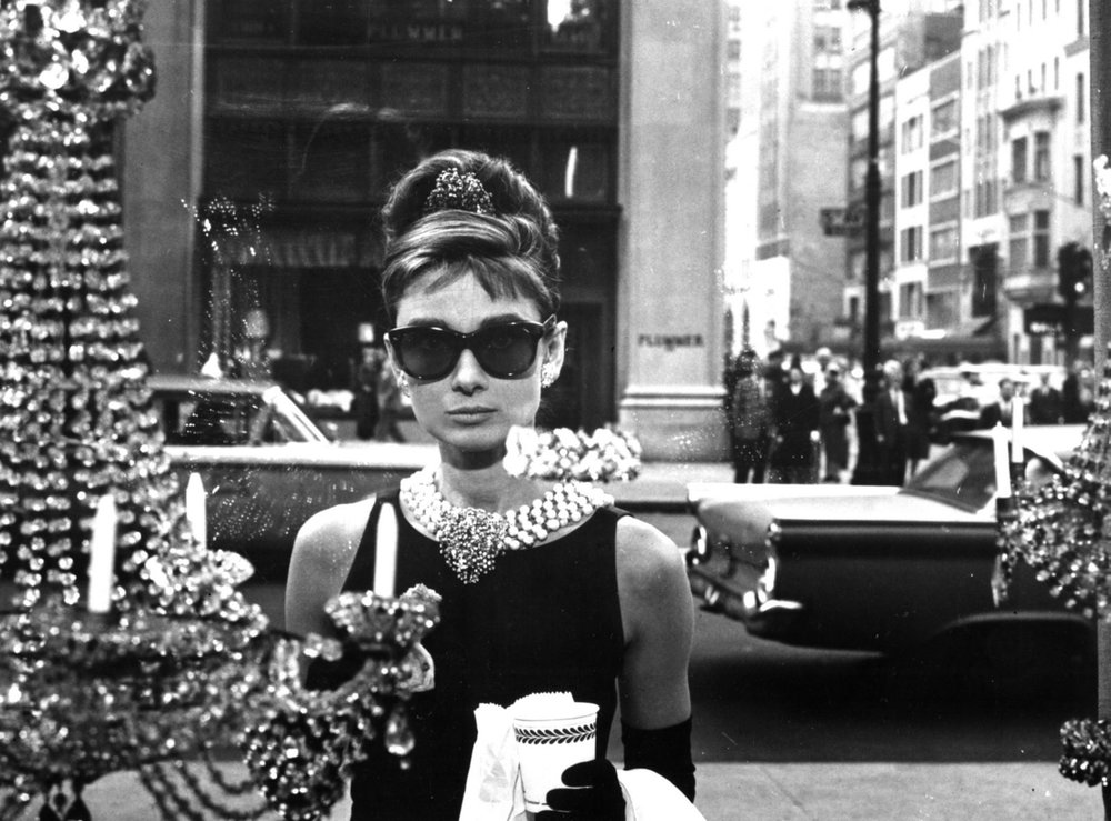 Audrey's sunglasses worn in Breakfast at Tiffany's were from the iconic brand Oliver Goldsmith. You can still buy them  here .