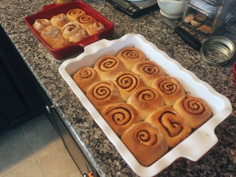 "Hot from the oven, I always take a moment to admire the swirls. These are the ""leftover rolls"", the pieces that came from the end of the rolls and weren't pretty enough to give to the church breakfast. My family was kind enough to eat them for me."