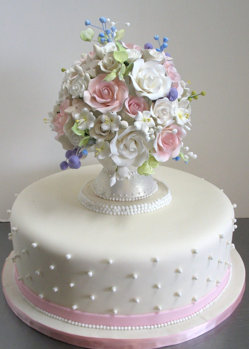 White cake with sugar vase