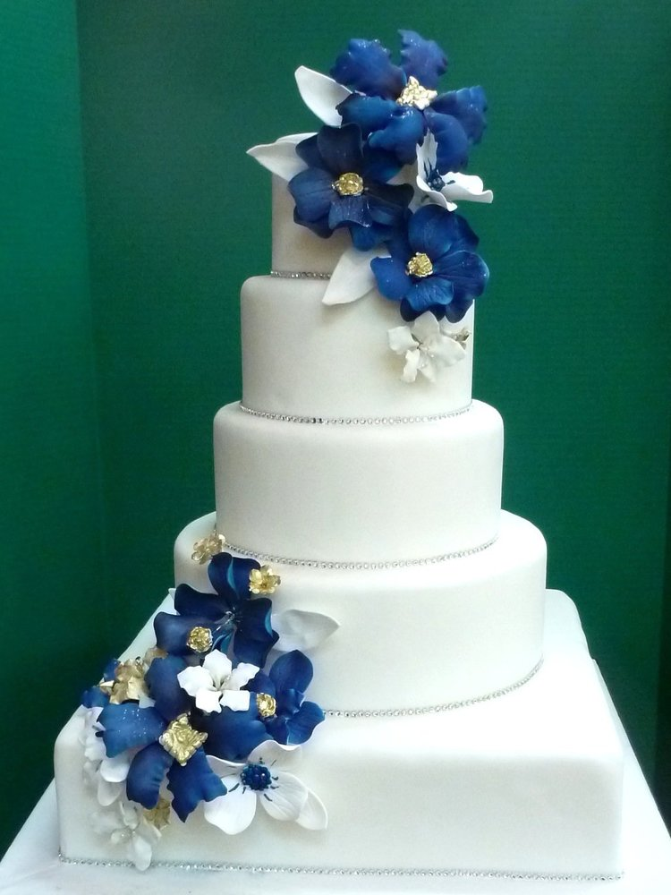 Wedding cake with blue velvet sugar flowers