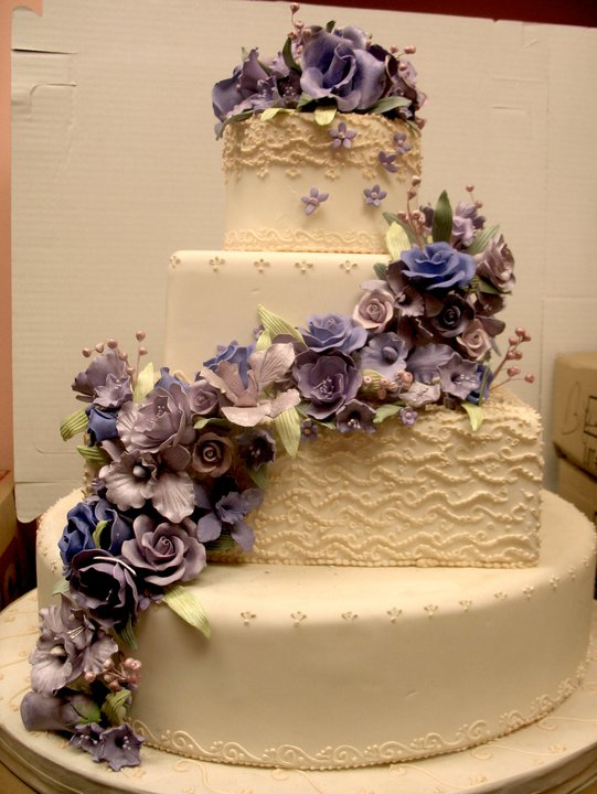 Wedding cake with draping purple sugar flowers