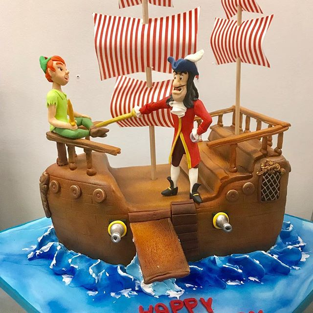 Pan and Hook sailed out of here this week.  We loved working on the details to make this a really special birthday cake!  #edibleart #peterpan #captainhook #birthdaycake #neverneverland #3dcake #fondantcake #fondant #dccake #bethesda #washingtondc