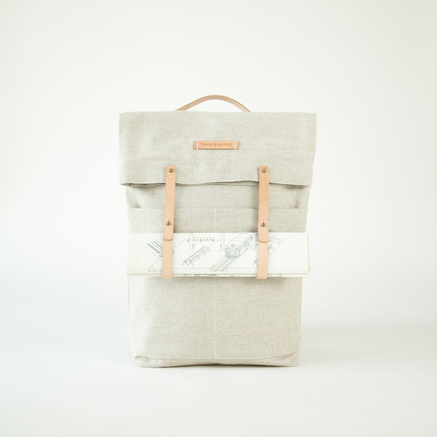 THISISPAPER  Newspaper Rucksack  Thisispaper just announced new addition to their collection of rucksacks made from cotton canvas, tanned leather, and string. These high quality bags are still sustainable and built with the same care and detailed design.