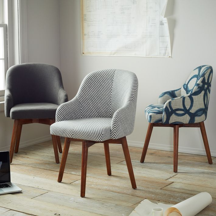 WEST ELM  Saddle Office Chair  A restock of their comfy and elegant swivel saddle chairs with a new blue and gray fabric motif.