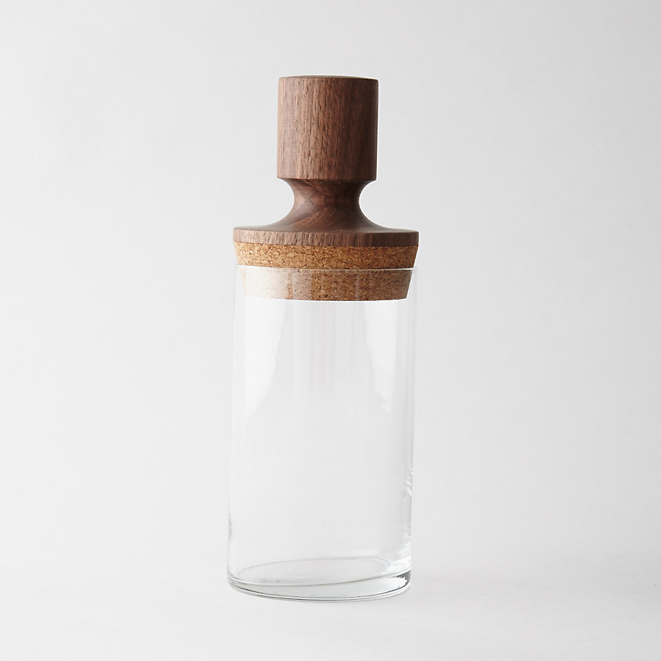 Intended for use in the kitchen to store dry goods, this vessel can also be used throughout the entire household. Crafted from thin glass and sealed with large cork stopper with turned walnut handle.  FORT STANDARD   $84