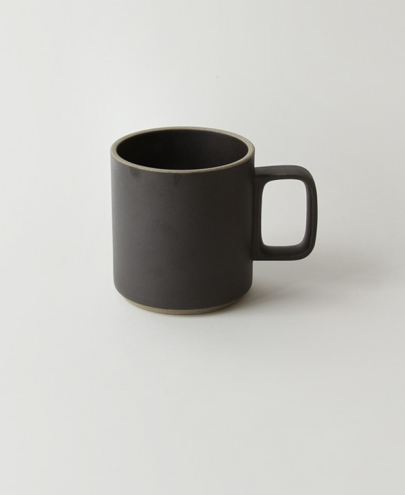Tall black mug with soft sand texture. HASAMI  $30