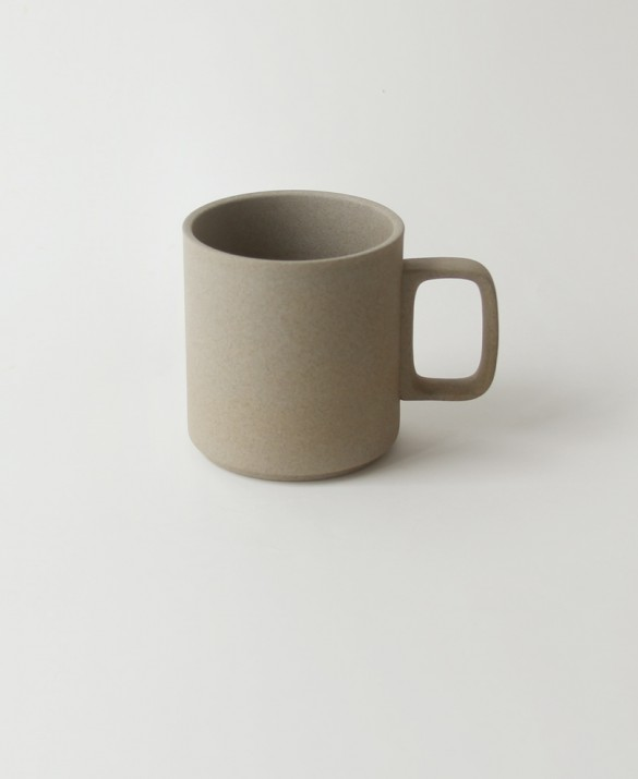 Tall beige mug with soft sand texture. HASAMI  $20