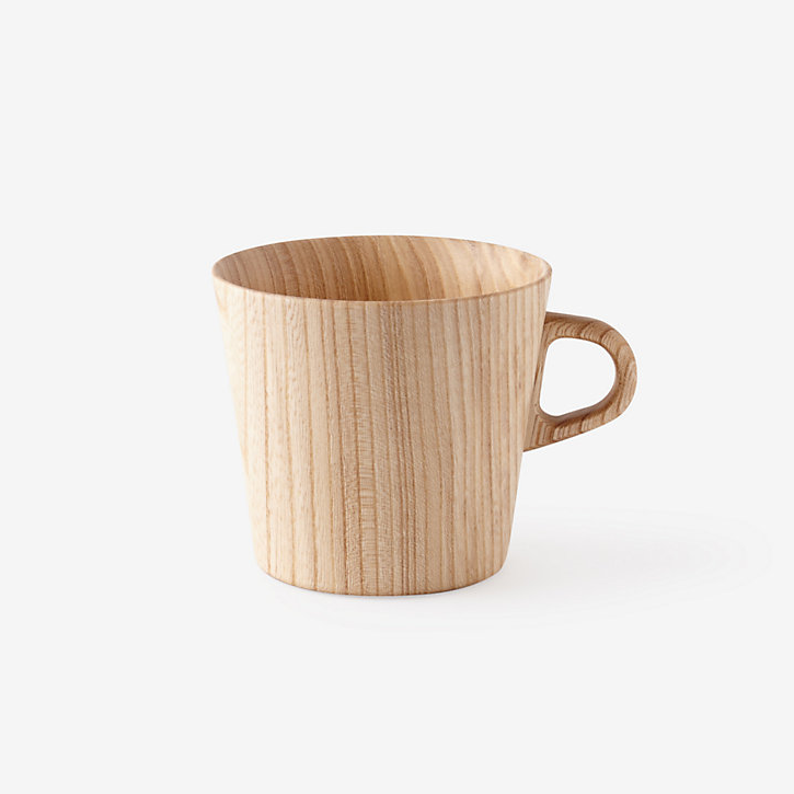 A unique, aralia wood mug designed by Oji Masanori and hand-crafted in the Takahashi Kougei wood workshop in Hokkaido. Sanded down to a lightweight 2mm, allowing natural light to glow through yet thick enough for durable insulation. OJI MASANORI $72