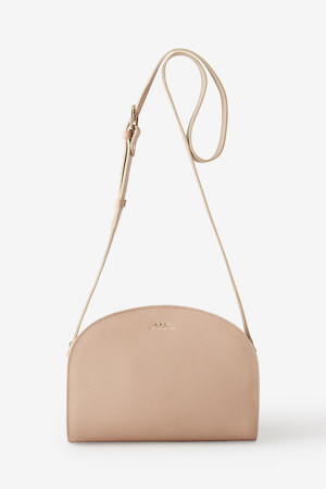 Half Moon Bag   The signature bag from A.P.C. in smooth calfskin leather. Structured, half-moon silhouette with a two-way zip and adjustable shoulder strap.  APC $440
