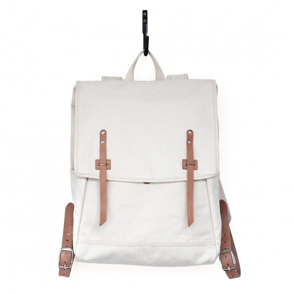 Natural Canvas Rucksack   One main compartment with interior pocket. Two exterior side pockets. Padded shoulder straps. Nickel-plated hardware. Heavy Cotton Duck with webbing.  MAKR $185