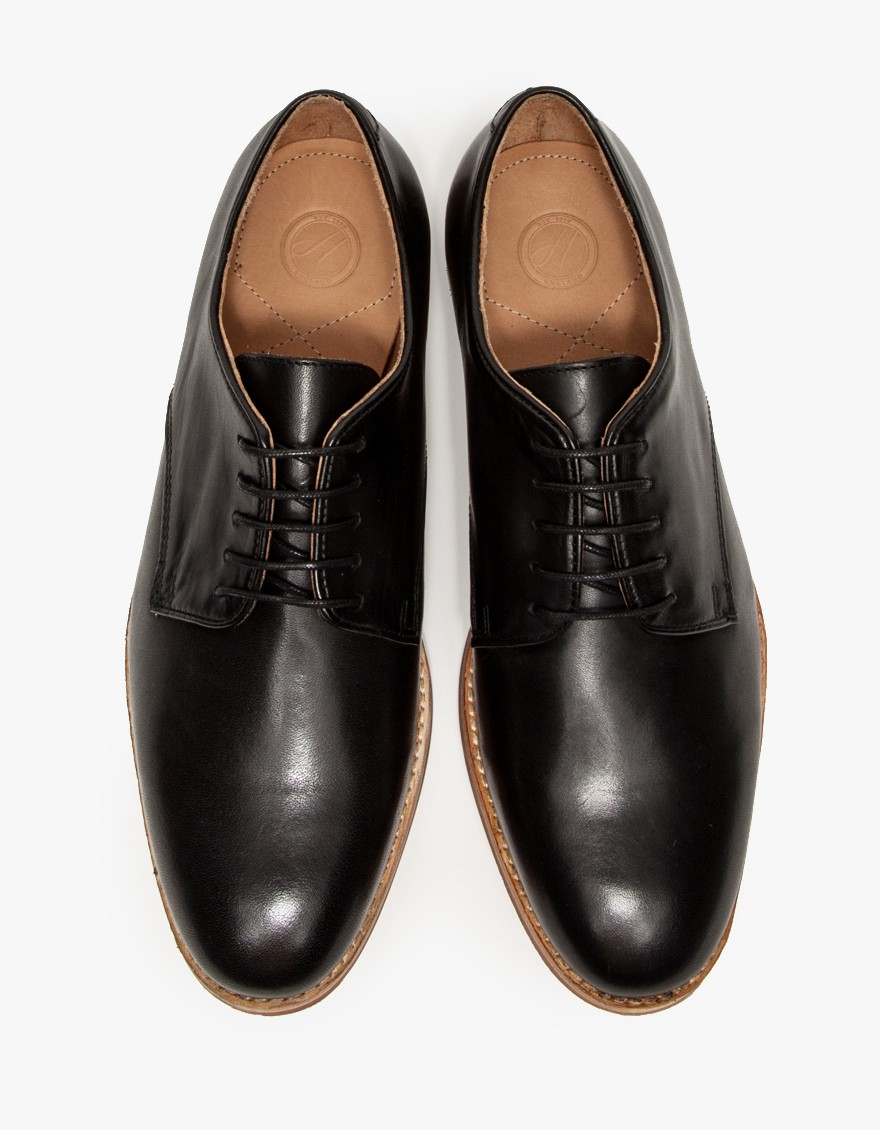 Hadstone in Black A traditional derby shoe from H by Hudson with casual styling. Features black leather uppers, natural leather sole, rubber sheet on the bottom and lace-up closure. H FOR HUDSON $160