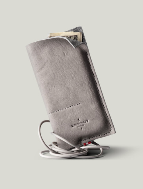 Wild Phone Case Washed soft Italian leather with minimal stitching. The wool interior wraps around your phone and two hideout pockets for your cash and cards. HARD GRAFT $85