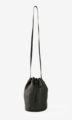 Small Bucket Bag Small drawstring bucket bag in unlined natural milled soft leather for minimal shoulder bag. BAGGU $140