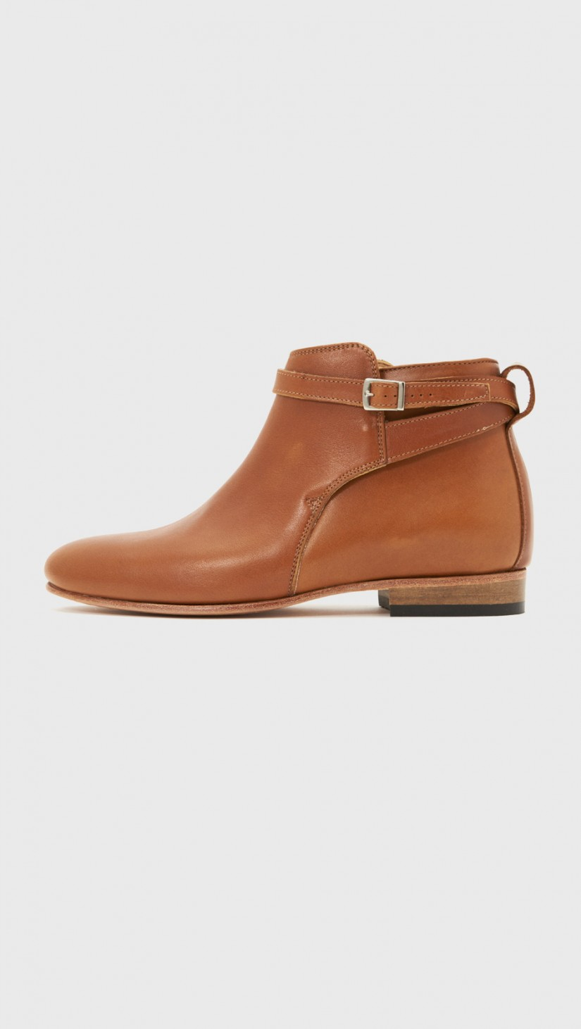 Flat Ankle Boot   Honey whiskey ankle boot with buckled wrap strap.  DIEPPA RESTREPO $415