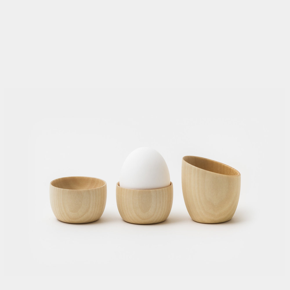 This linden wood breakfast set is designed by Rina Ono and handcrafted by the Takahashi Kougei Workshop in Hokkaido, Japan. Inspired by the shape of an egg, the Cara series products are a pleasure to hold with their smooth, warm surfaces. Set includes two egg holders and a creamer. RINA ONO $65