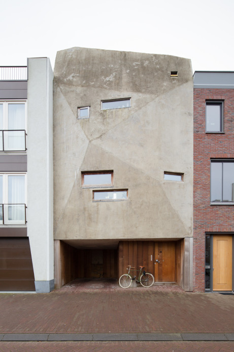 This Brutalist inspired architecture by Joris Brouwers and Nicky Zwaan is a massive asymmetrical facade with a curious structure made of wood, glass, and concrete and has an impressive interior that is a refuge for a modest living. Each room is well utilized for their own use and kept for a sustainable living.