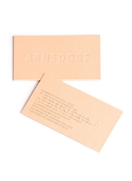RoAndCo designed the identity for Australian fashion designer Jade Sarita Arnof of Arnsdorf. The business cards and labels are minimal and buff which evokes the sandy color of deserts for its spring collection.