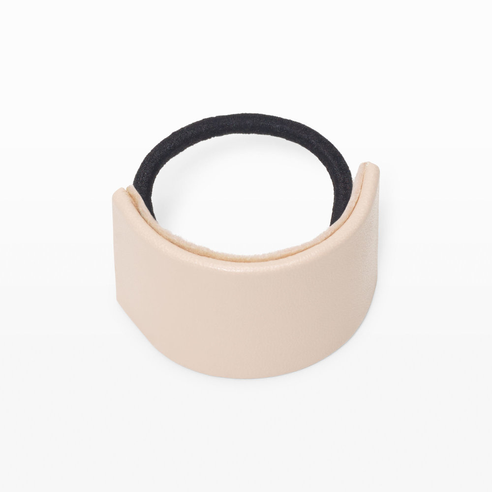 CLUB MONACO Curved Hair Tie  A very good excuse to wear your hair up, the curved hair tie is a stylish upgrade to your go-to ponytail.