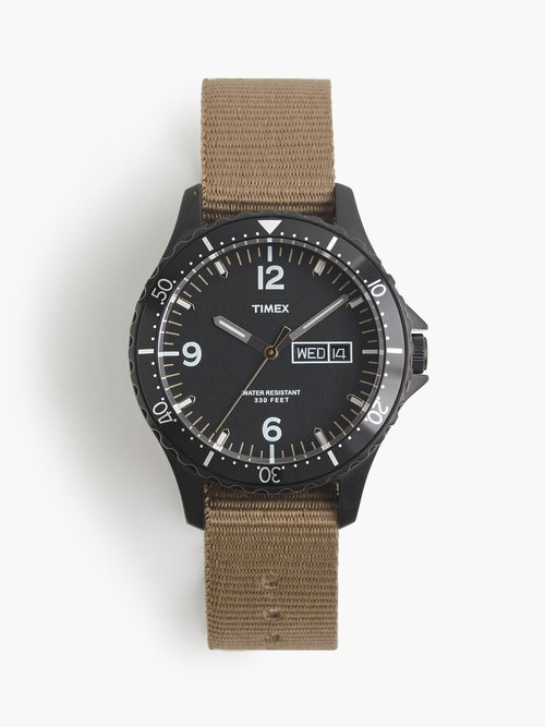 TIMEX Timex for J.Crew Watch  J.Crew's collaboration with Timex created a diver-style watch with an all-black look inspired by stealthy tactical timepieces. Featuring a quartz analog movement with a functioning bezel, it's the perfect no-fuss companion that's as dependable on land as it is in the water.