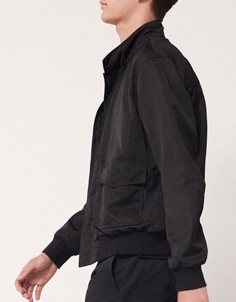 CLUB MONACO Tonal Raglan Bomber  The classic bomber style is reimagined in a warm weather-friendly fabric. Featuring a slim fit with contrasting navy woven fabric at the body and black technical fabric at the sleeves, our tonal raglan bomber is the perfect transitional layering piece.