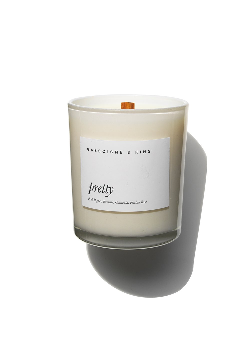 GRITTY PRETTY Pretty Candle  Pretty is for the divine feminine. A charming and alluring bouquet of jasmine, gardenia and Persian rose with the surprising twist of pink pepper and coriander. In life, some things are for certain; the French do good cheese, the Italians make good Sangiovese and  Pretty  will uplift and make any home inviting.