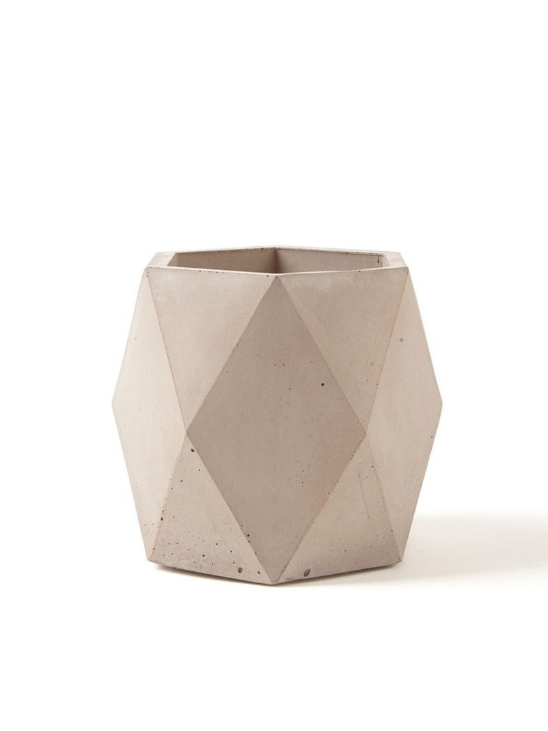 FACTOLAB Ore Geometric Pot  This beautiful pot is ideal as a planter or a short vase, and the pink hue that Facto worked hard to create is a celebration spring. Its geometric design is unique and causes the pot to change shape depending on the position. It's perfect for your indoor plants as it has a cork protection on the base to prevent scratches, and the surface is sealed with non-toxic product to make it waterproof.