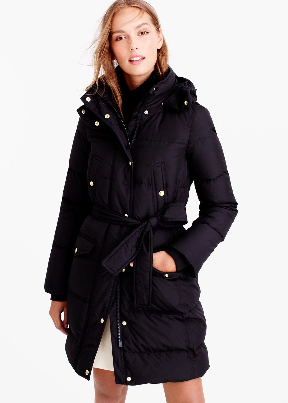 J.CREW Wintress Belted Puffer Coat  Winter, meet your new nemesis: Our long down puffer coat is a cold-weather rebel, designed to insulate (even when you can't remember what the sun feels like). A roomy hood retains extra degrees while a waist-nipping belt makes the silhouette flattering. We don't think keeping warm should mean becoming a human sleeping bag.