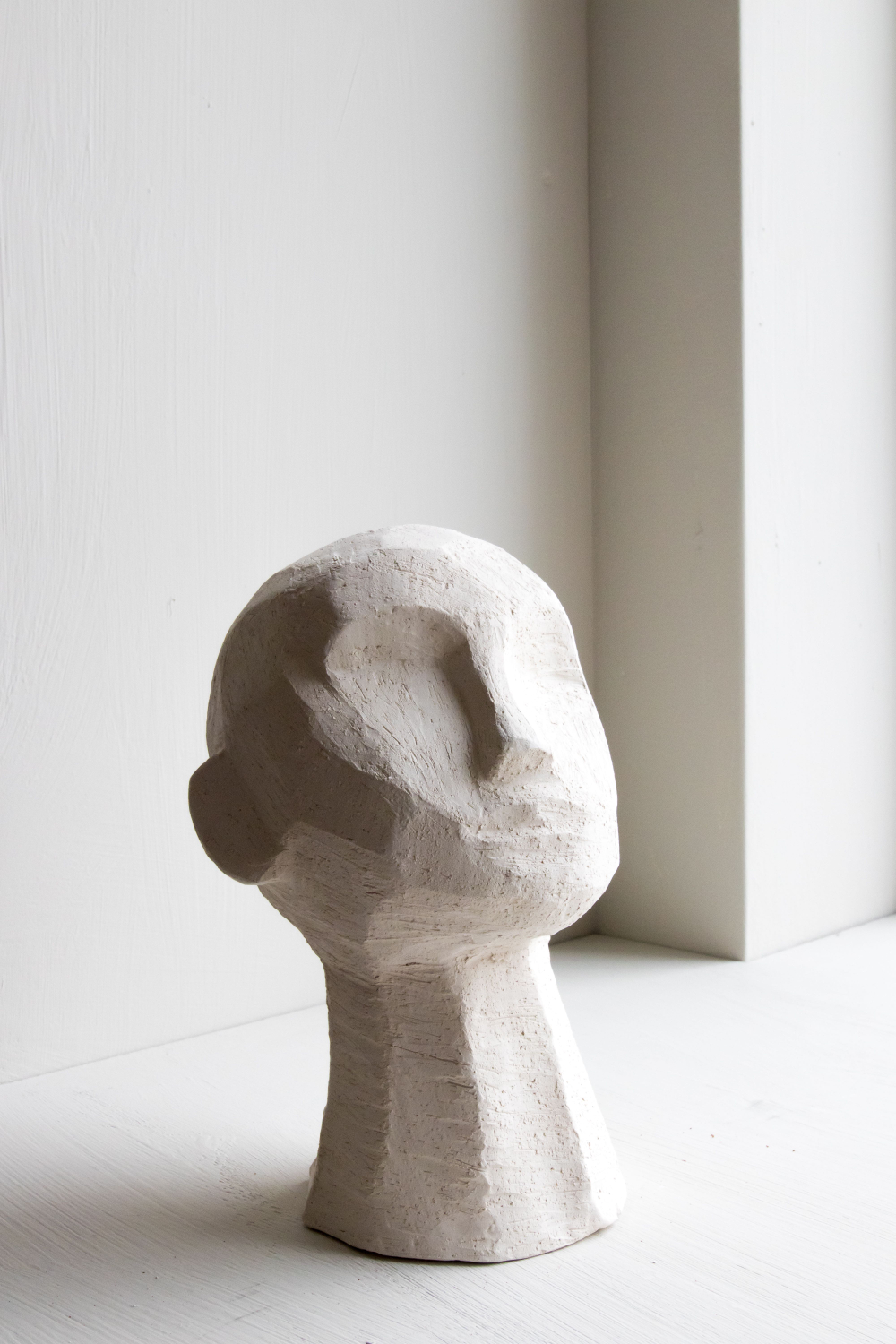 KRISTIINA  Handmade stoneware clay and metal head sculptures. See availability on her online shop.