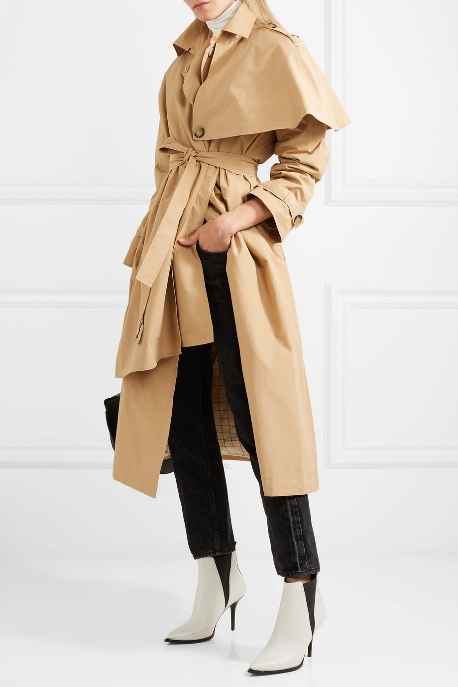 AWAKE Cape effect Trench Coat  Once you've seen one beige trench coat, you've seen them all - right? A.W.A.K.E.'s founder Natalia Alaverdian is here to prove you wrong. Part of her Resort '18 collection, this version of the iconic staple is tailored with an asymmetric cape-effect layer. Made in the UK, it's cut from cotton-blend that's weighty enough to keep you warm but light enough to wear over shirts and sweaters without looking bulky.