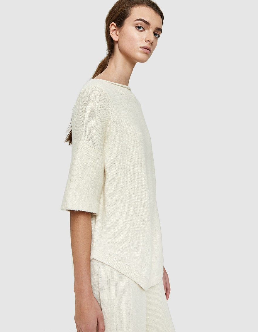 LAUREN MANOOGIAN Dovetail Pullover  Hand-loomed sweater from Lauren Manoogian in White. Bateau neckline. Exaggerated drop shoulders. Short sleeves. Round hem. Boxy silhouette.