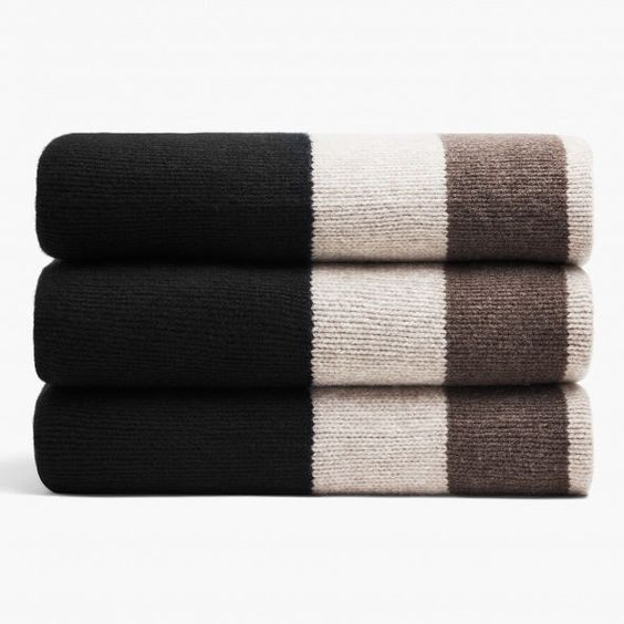JAMES PERSE Chunky Cashmere Striped Blanket  This luxurious jersey knit cashmere blanket is knit with multiple colored yarns into an original James Perse graphic stripe design. This heavy weight cashmere blanket adds visual texture when draped on the edge of your bed or draped over the couch. All edges self-start.