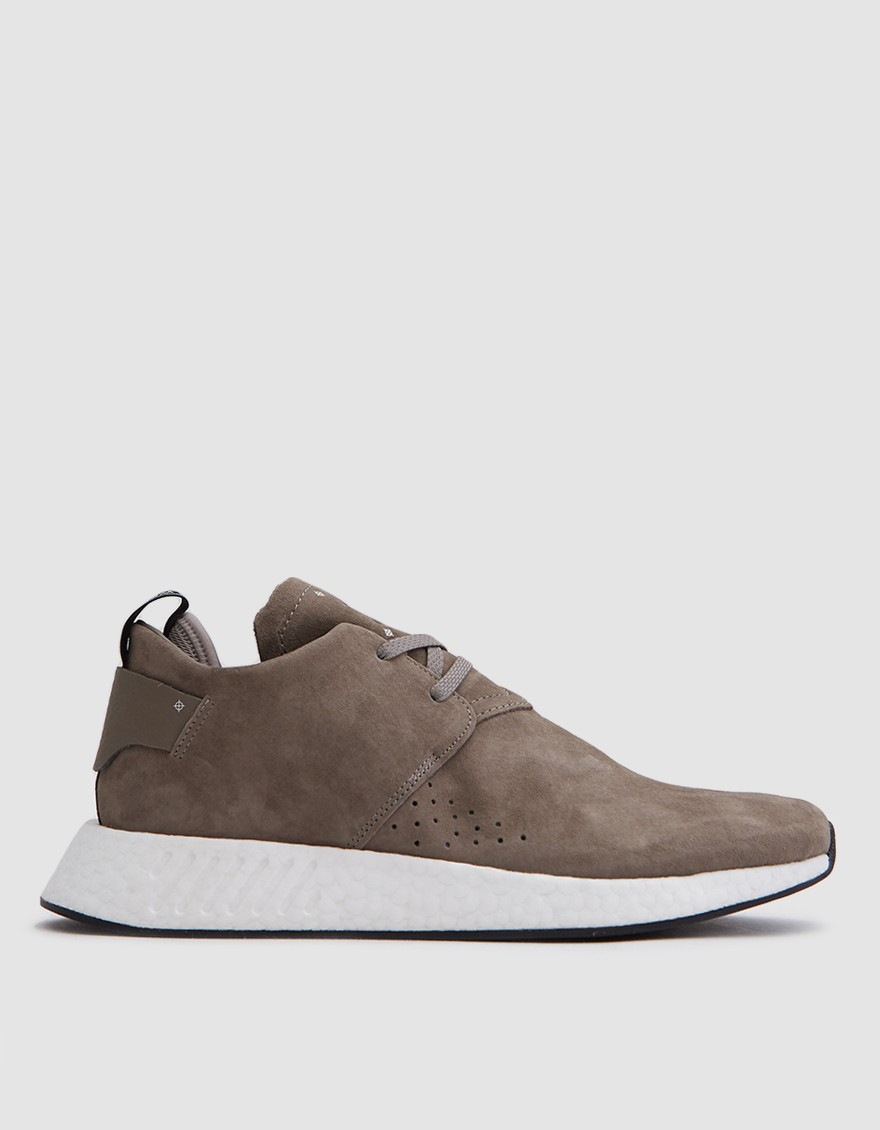 ADIDAS NMD_C2 in Simple Brown  Chukka-inspired runner from Adidas in Brown. Premium pigskin nubuck upper. Lace-up front with reflective laces. Perforated details at lateral side with reflective underlay. Neoprene heel insert. Premium leather heel patch with signature NMD heel pull. Molded EVA midsole plug at medial side. Adidas branding throughout.
