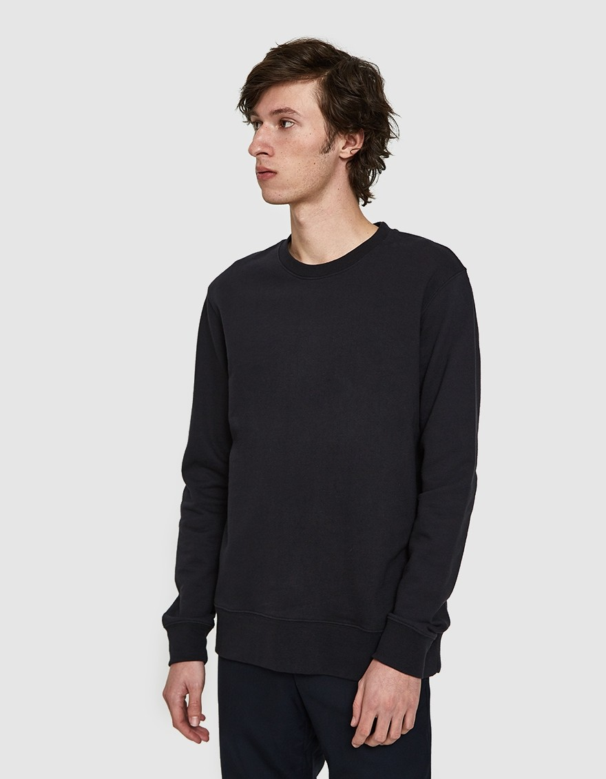 NEED Boxy Crew in Navy  Classic crewneck sweatshirt from NEED in Navy. Crewneck collar. Tonal stitching. Internal twill tape across neck & shoulder seam. Ribbed trim. Loop back French terry. Straight hem. Straight body silhouette.