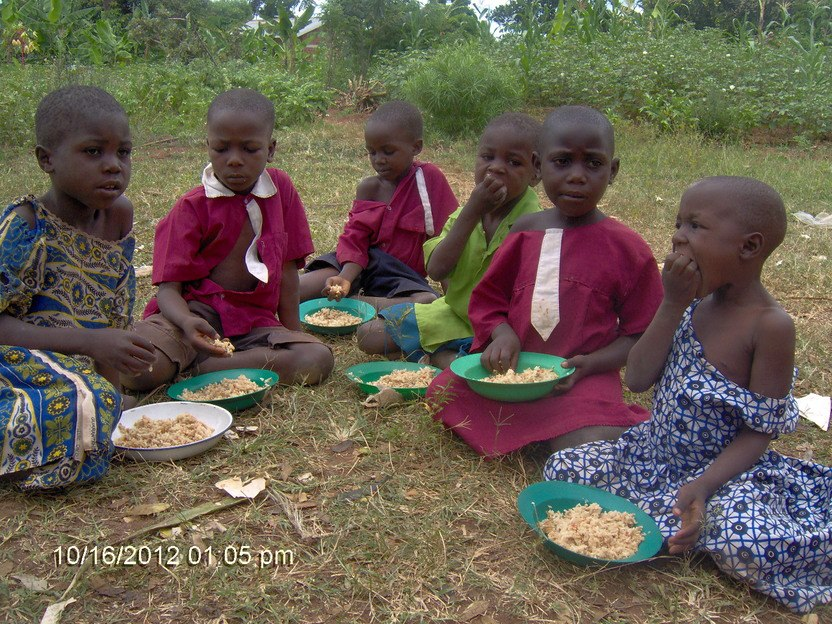 Children in Uganda eating nutritious meals from Kids Against Hunger
