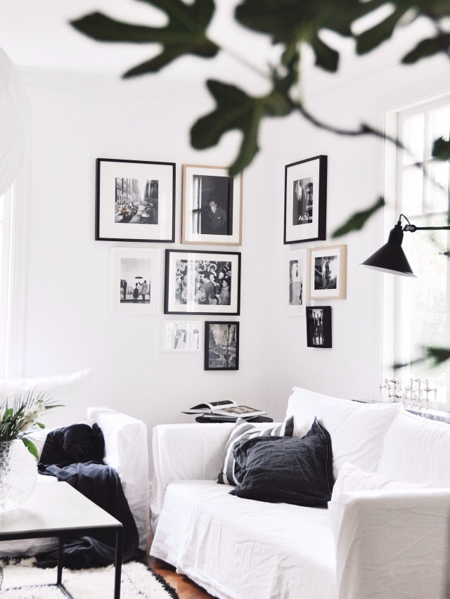 Bright monochrome living with abstract prints