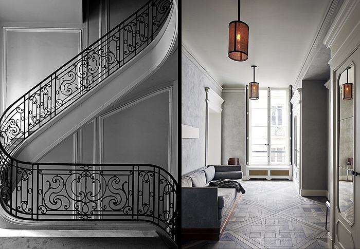 Ornate and decorative curved balustrade. Mottled grey hallway with bright light and perfect parquetry.
