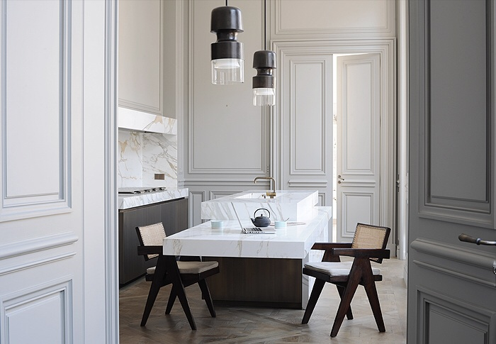 Solid marble kitchen with breakfast bench.