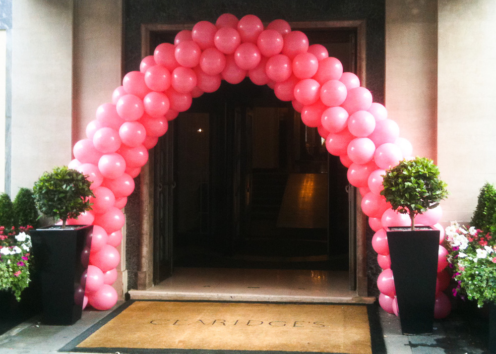A welcoming  PINK  arch at Claridges
