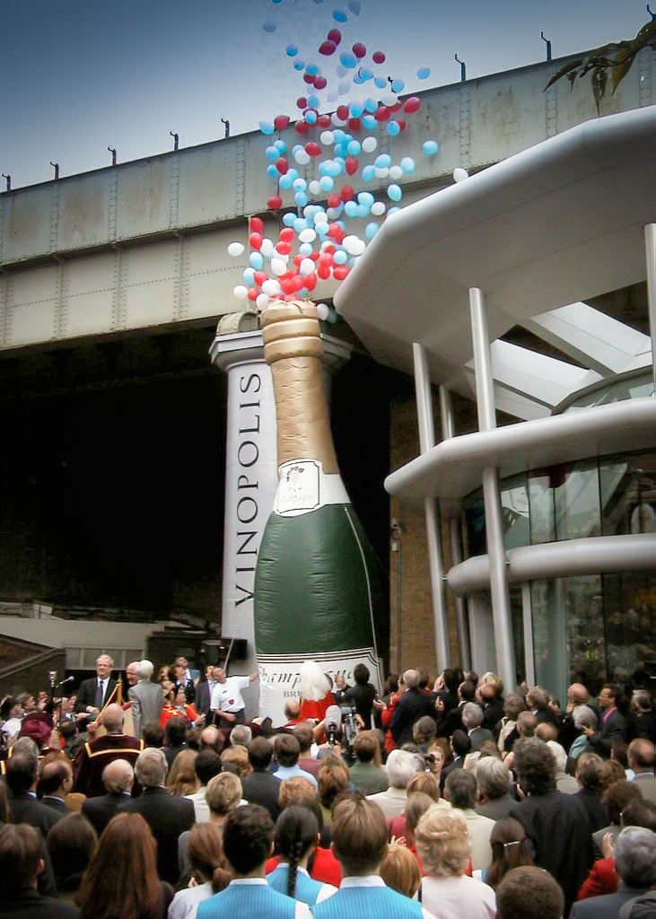 Popping the cork at the launch of Vinopolis...