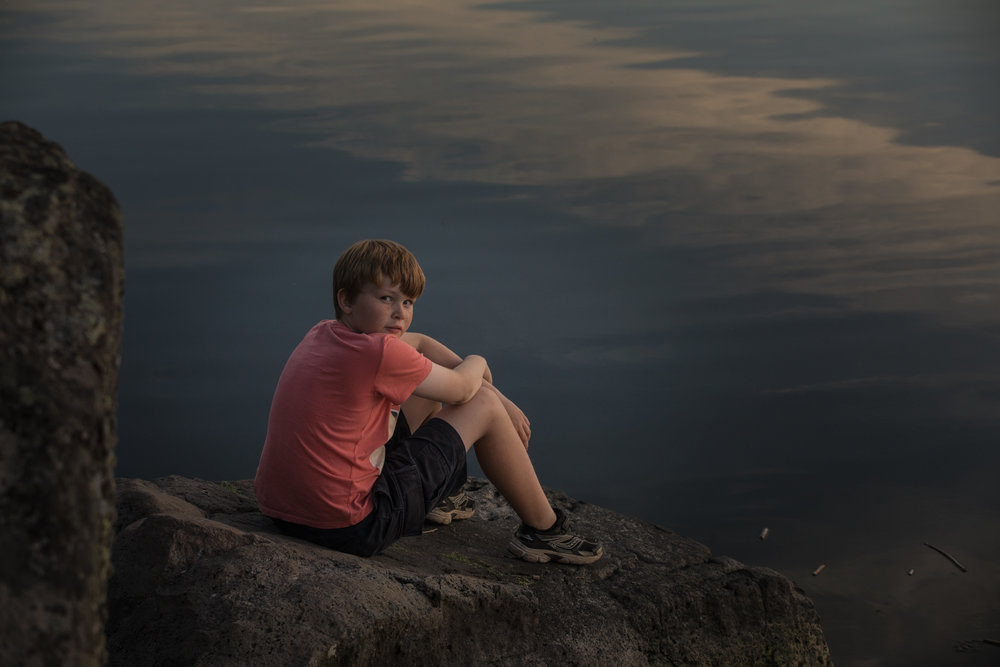 Calm evening by the lake with William in Oregon. Found a small campground where we stayed next to a lake with Pelicans.