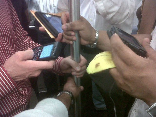 Gadgets on commute by arvindgrover via Flickr Creative Commons.jpg
