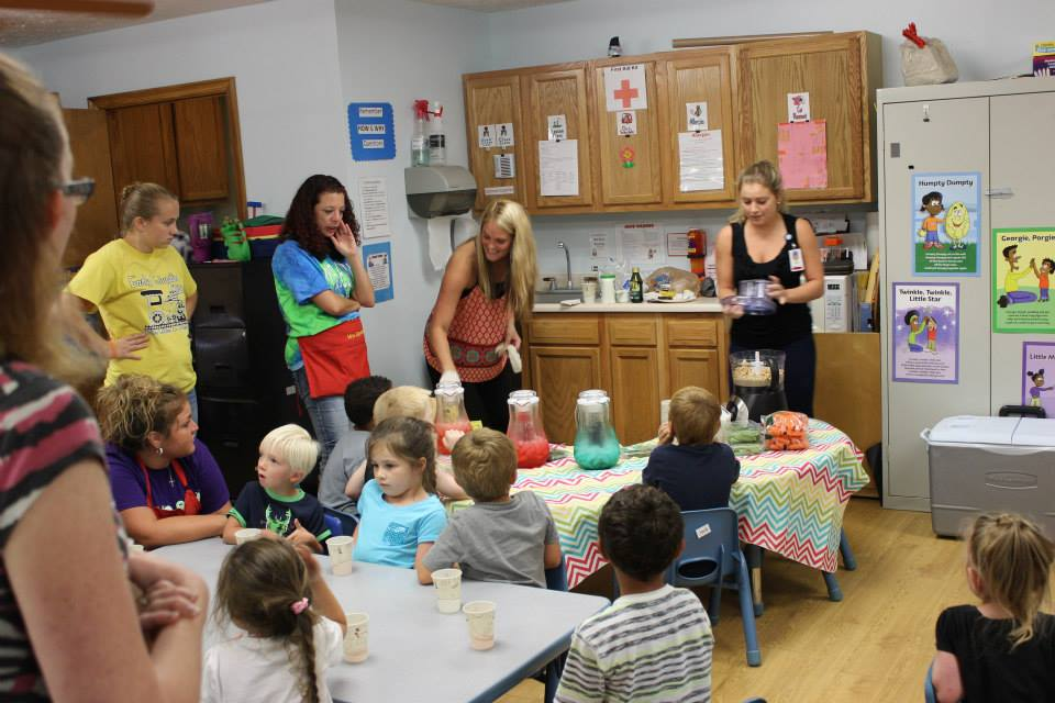 Our Summer VISTA's conducting a food demo for one of our KEY 2 a Healthy Start sites.