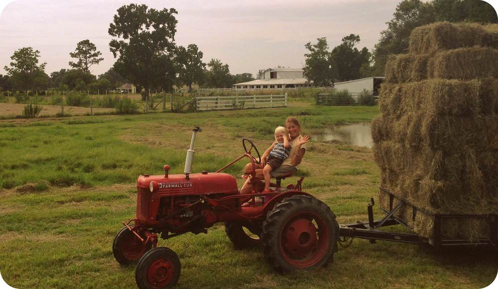 mom and kai on tractor edit.jpg