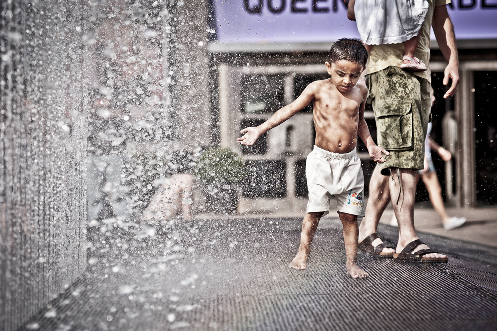 a boy in the fountains on London's Southbank