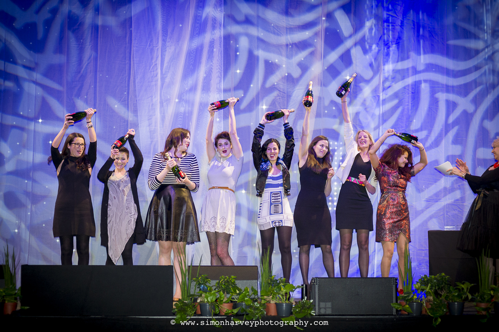 award_winners_celebrate_on_stage.jpg
