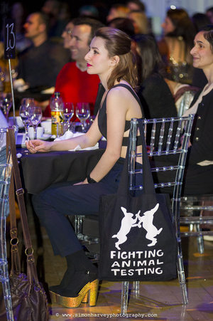 Pretty girl with fighting animal testing bag