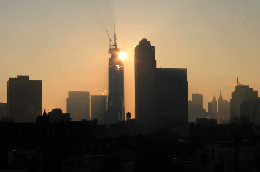 Time-lapse sunrise behind One WTC.