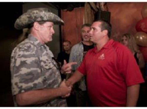 Ted Nugent, left, shares words with Master Sergeant Davey Lind during the annual safetyheroes.org event.