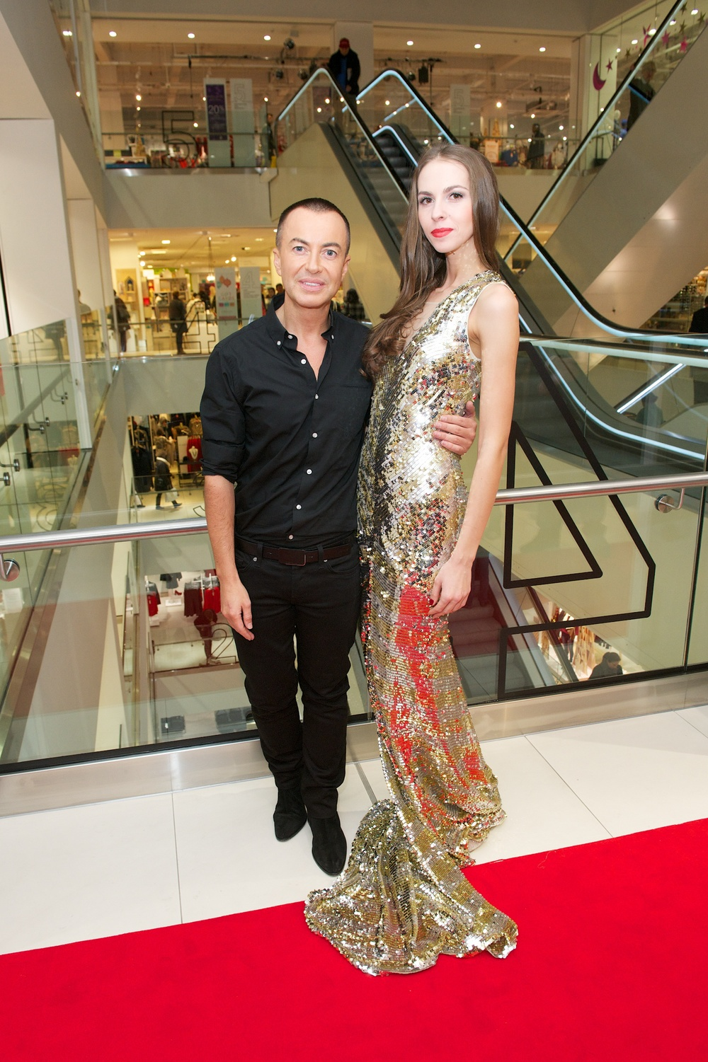 JULIEN MACDONALD STEPPED OUT ONTO THE RED CARPET FOR THE GLAMOROUS CHRISTMAS DEBENHAMS STORE LAUNCH. MODELS AND STAFF TOOK TO THE RUNWAY ILLUSTRATING DEBENHAMS' PLEDGE TO SATISFY THEIR CUSTOMER'S DESIRE TO SEE MORE REALISTIC IMAGES IN FASHION.
