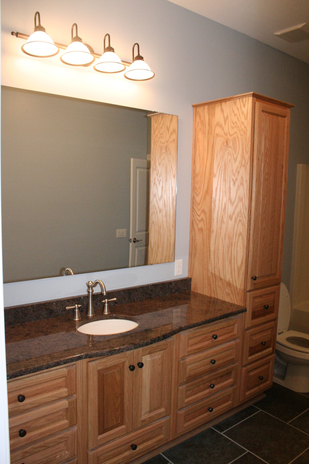 Custom built cabinets and granite countertops